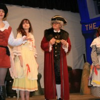 Katherine Apps (Robinson Crusoe), Megan Moore (Polly Perkins), Martin Apps (Mayor Perkins) & John Sansom (Clara Crusoe)